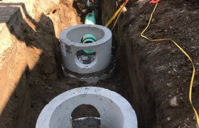 Selly Excavating installing a residential septic tank system